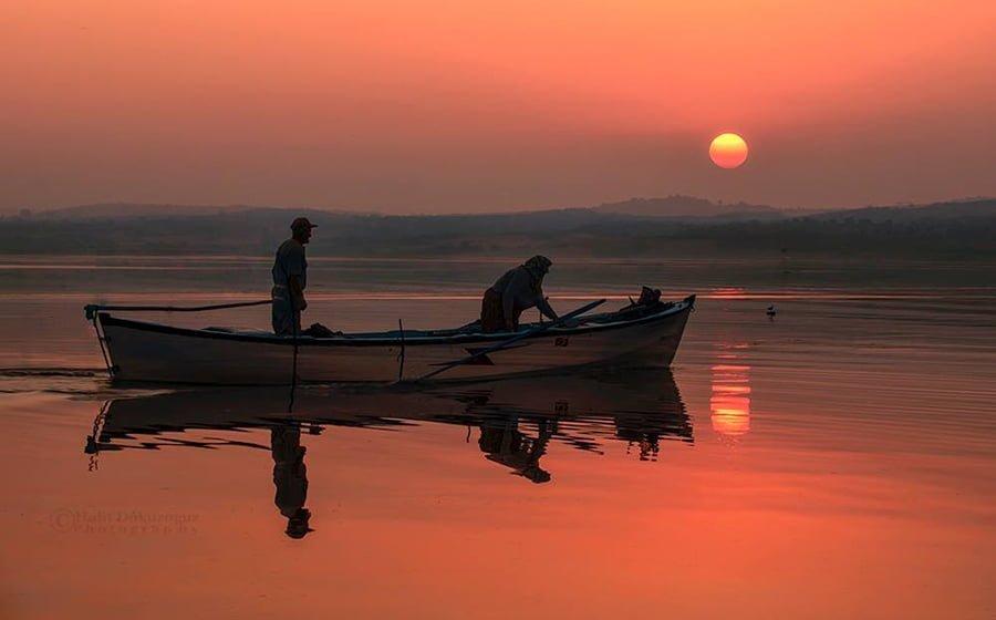 Gün doğumu balıkçıları